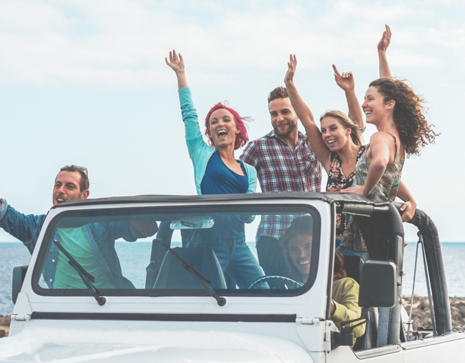 friends in a jeep by the ocean
